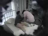 Asian Nurse With Patient At Hospital